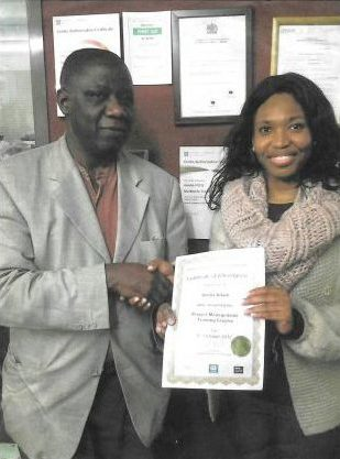 Volunteer receiving certification on completion of a course