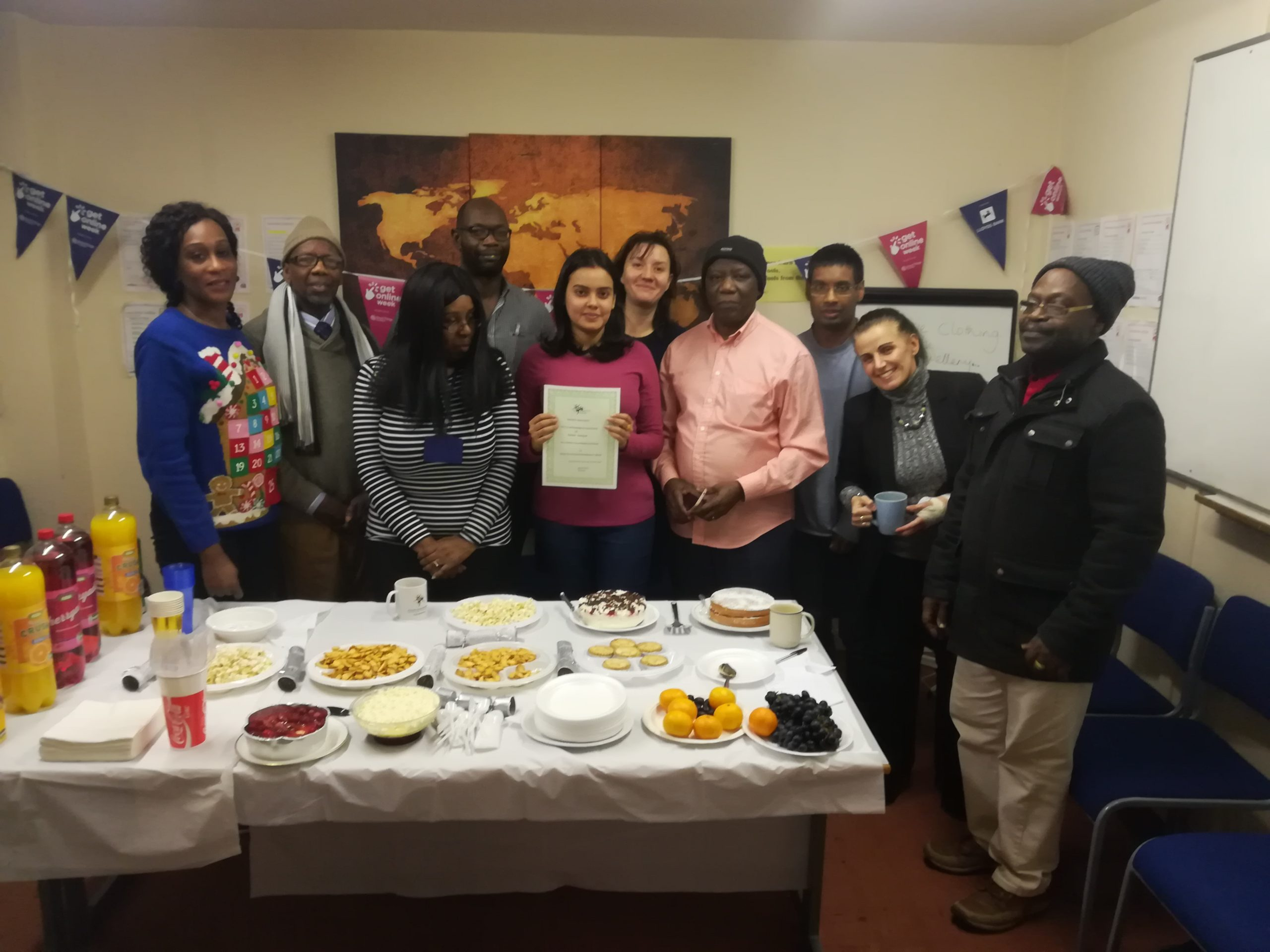 Celebration of volunteering achievement at end of year party