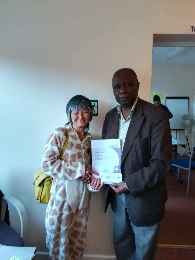 Volunteer receiving certificate