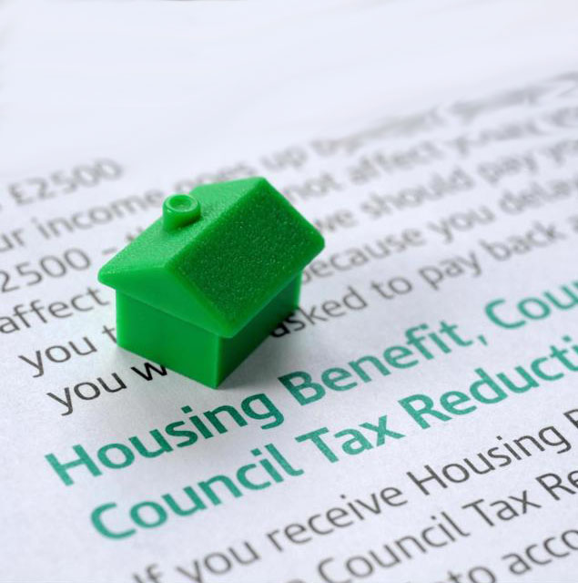 Monopoly house piece on document with benefits
