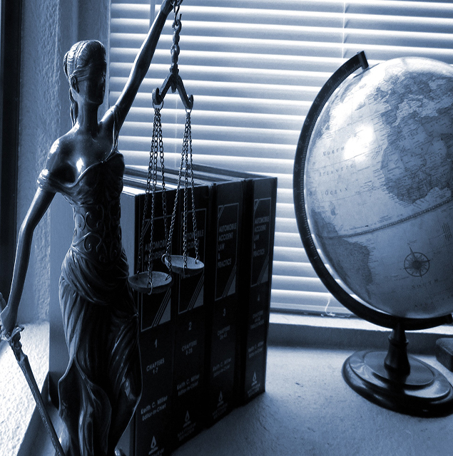 Lady justice statue, books and a globe